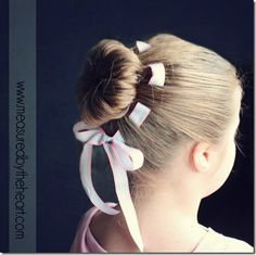 flower bun with woven ribbon...perfect little flower girl hairdo...