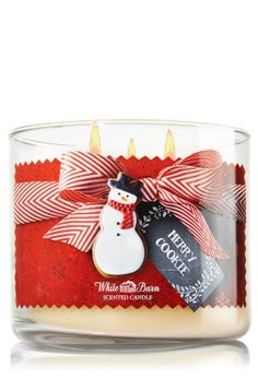 """Merry Cookie - 3-Wick Candle - Bath & Body Works - The Perfect 3-Wick Candle! Featuring the highest concentration of fragrance oils, an exclusive blend of vegetable wax and wicks that won't burn out, our candles melt consistently & evenly, radiating enough fragrance to fill an entire room. Made with love and topped with a decorative tin lid! Burns approximately 25 - 45 hours and measures 4"""" wide x 3 1/2"""" tall."""
