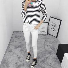 We can't imagine anything more perfect than this stripe shirt and white pants combo!