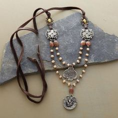 Leather mixed with pearls. The silver medallions are cool as well.