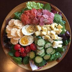 Romaine lettuces and spinach salami pepperoni cheese crackers grape tomatoes cucumbers two cheeses a soft-boiled egg and hemp seeds. I promise not to waste any even if I have to enlist a little help.