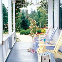 Adirondack chairs in soft sherbet tones pretty up a porch that is both old-fashioned and fresh at the same time. Cottage Porch, Home Porch, Cottage Bedrooms, Porch Garden, Cozy Cottage, Cottage Living, Outdoor Rooms, Outdoor Living, Outdoor Decor