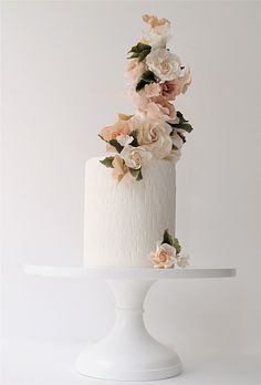 White One-Tier Cake with Tall Flowers @ginarenee096 I could see making the cake more asymmetrical to further emphasize the height of the flowers and give it more angle overall