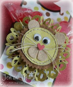 This cute lil' door hanger {cut with Silhouette} uses The Cat's Pajamas' Heart Rosette CutUps die to create a fun lion mane that is complemented with felt and my most favorite go-to product…linen thread. The ears are created from the egg in the Eggs in a Basket CutUps die set and I used the heart from the birdhouse in the Home Tweet Home CutUps die set.