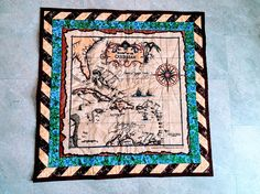 Old World Map Quilt Wall Hanging Pirate Map Map Fabric https://www.etsy.com/listing/508113980/old-world-map-quilt-wall-hanging-pirate?ref=related-1