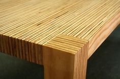 coffee table made of two-inch strips of plywood glued together...i love the striped texture