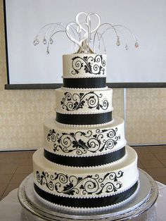 Love!! Minus the weird shit on top  Black & White Wedding Cake