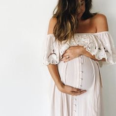 SF: love the length flow and detail in this dress for my maternity photos and nursing this summer after baby is born.