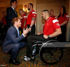 Prince Harry (left) and Canadian Prime Minister Justin Trudeau (left, rear) meet members of the Canadian Invictus Games 2016 team at the Royal York Hotel on May 2, 2016 in Toronto, Canada. Prince Harry is in Toronto for the Launch of the 2017 Toronto Invictus Games before heading down to Miami and the 2016 Invictus Games in Orlando.  (Photo by Peter Byrne-Pool/Getty Images)