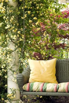Love this vignette....love how the pillow and cushion coordinate with the jasmine and roses(?).