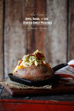 Slow Cooker Apple, Bacon, and Leek Stuffed Sweet Potatoes by @sharedappetite with a cheddar mornay sauce.  PLUS learn how to make perfect sweet potatoes in your slow cooker!