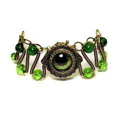 steampunk jewelry | Steampunk Jewelry - Green Beholder Eye Bracelet by CatherinetteRings