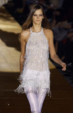 FW Memories: Carmen Kass walks the runway in a #RobertoCavalli beaded fringe top