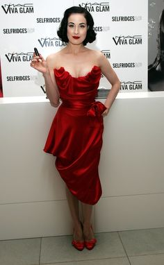 Dita Von Teese - I find many of her dresses absolutely beautiful, but a lot less cleavage goes a long way!