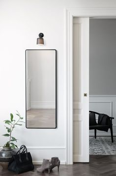 Find your favorite Minimalist living room photos here. Browse through images of inspiring Minimalist living room ideas to create your perfect home. Minimalist Living, Minimalist Design, Nordic Interior, Interior Design, Hallway Mirror, Mirrors, Living Room Photos, Mirror With Lights, Find Furniture