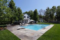 Family style home and swimming pool with diving board