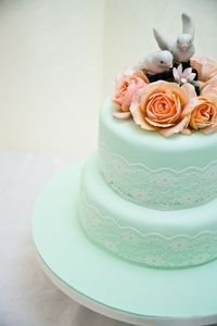 mint green, lace, orange roses, and vintage topper wedding cake