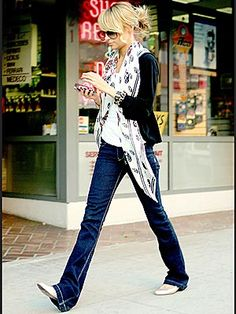 Chic and casual. Love the use of the scarf---how can she stand walking on her jeans like that?!?