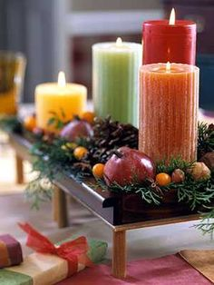 fall-decorating-ideas-candles, apples, nuts and berries centerpiece