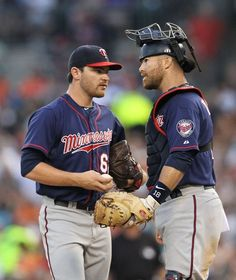 Liam Hendriks #62 of the Minnesota Twins talks with Ryan Doumit #18 during the game against the Detroit Tigers at Comerica Park on July 2, 2012 in Detroit, Michigan