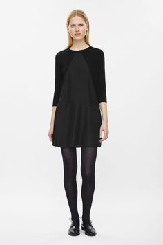 This dress is made from light-knit cotton with a contrast triangular fron panel. Flaring towards the hemline, it has contrasting back zip, 3/4 sleeves and neatly ribbed edges.