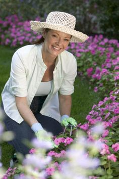 Simple blue jeans, white t-shirt, button up long sleeve shirt, straw hat and garden gloves.