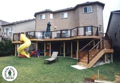 trex deck with slide--have slide end end up under deck to kids play area-picnic table and sandbox.. NOW THATS COOL