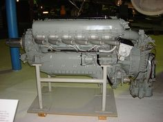 A left side view of a gloss grey -painted aircraft piston engine on static display