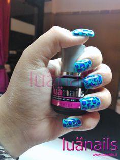 Ricostruzione unghie leopardata blu sigillata con gel unghie lucido Sealer