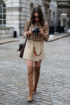 Street Style - Tigh high boots & suede wrap skirt - monstylepin #fashion #style #streetstyle #trend #beige #bvrown #tartanshirt #wrapskirt #suede #boots