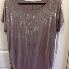 Brown Top with Gold Sparkles Light chocolate top with gold sparkle design.  Crimped sides at the bottom.  Short sleeves. Worn once- excellent condition.  Very soft & flowing. Tops