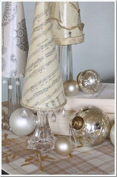 Sheet Music Tree, apply modgepodge to cone then top coat.then trim at bottom and sprinkle with glitter and use hot glue with bottom trim and wine glass or candle sticks