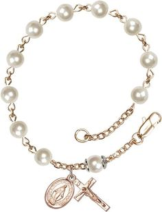14 Karat Gold Rosary Bracelet features 6mm Faux Pearl beads. The Crucifix measures 5/8 x 1/4. Each Rosary Bracelet is presented in a deluxe velvet gift box. Han
