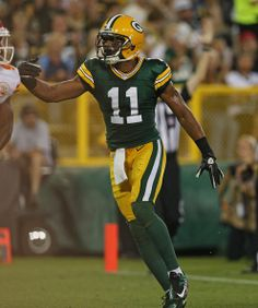 Jarrett Boykin #11 of the Green Bay Packers celebrates a touchdown catch against the Kansas City Chiefs during a preseason ga...