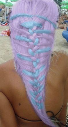 Lavender and baby blue hair in plaited braid. Mermaid hair. Pastel hair color. Creative hair style.