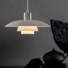 The PH 4/3 Pendant Light is part of the three shade system developed by Paul Henningsen in 1925–1926. http://www.yliving.com/louis-poulsen-ph4-3-pendant-light.html