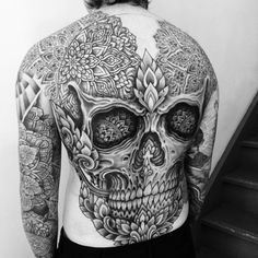 Huge Skull Tattoo With Flowers - http://www.tattooideas1.org/placement/whole-body/huge-skull-tattoo-with-flowers/