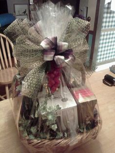 Over the years that ive been wrapping gift baskets ive found wine gift baskets are unique and fun to make notice the artificial grapes dangling from the bow this was created by tracey giftbasketappeal negle