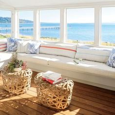 Windows in the Whidbey Island sleeping loft pop out, inviting sea breezes. | Coastalliving.com