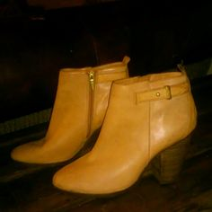 SOLD on another site Coach booties  will trade Size 9b tan coach booties the right boot has a small scratch on the toe and the pull strap is tore i guess thats what you call it. And each heel has a small white mark on them. Will trade for rock revival jeans or michael kots bag or watch Coach Shoes Ankle Boots & Booties