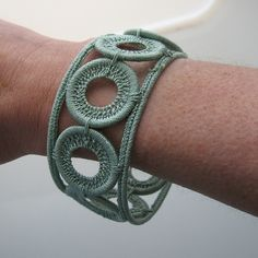 "Can't find the ""how to"" for this after much searching...but believe it's made up of wire and thread yarn...I believe I could duplicate..would like to try...SFrazer....pale green bracelet by Hooked Yarn, via Flickr"