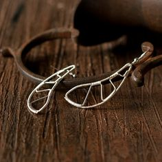 Geometric silver earrings  wire wrapped sterling by intuicio