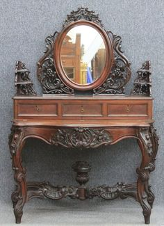 AMERICAN ROCOCO MAHOGANY CARVED VANITY in the manner of J.H. Belter height- 71, width- 49