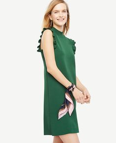 """Adorned with pretty ruffle sleeves, this refined shift defines feminine polish. Mock neck. Side slits. 35 1/4"""" from shoulder to hem."""