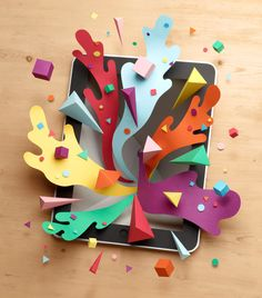 Owen Gildersleeve - iPad Design Guide. An illustration for the cover of Computer Arts' special iPad Design guide, featuring a hand-made paper iPad bursting with creativity.