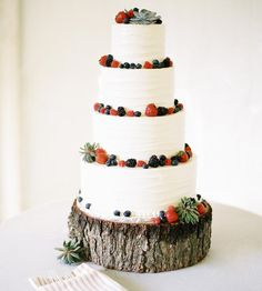 Pick a wedding cake that summons a taste of summer with in-season berries and fruits. Instead of traditional buttercream filling, consider a fresh raspberry puree or opt for a lemon cake with blackberry filling. l TheKnot.com