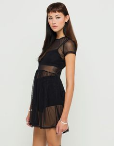 Dare to bare in our black sheer mesh dress! This floaty babydoll style dress features short sleeves, a high round neck, nipped in waist with gathered mini length skirt all in completely sheer net mesh. Team this see-through number with a ladder back bralette and hot pants or bandage style bodycon dress for layer appeal. Fabric Content: 100% POLYESTER - Model Wears: S - Model Height: 59