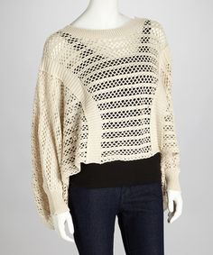 Slip into a timeless top with a touch of sophisticated style. This chic, open-weave sweater boasts subtle stripes and dolman sleeves for the perfect draped effect, creating an elegant staple sure to outlive the trends.