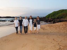 Family portraits on a Maui beach is a fun vacation activity the entire family will enjoy with a valuable take away product. View more images from this family photo shoot on a subdued and lovely voggy sunset at Kamaole III Beach Park: http://mauiislandportraits.com/family-portraits-on-a-maui-beach/