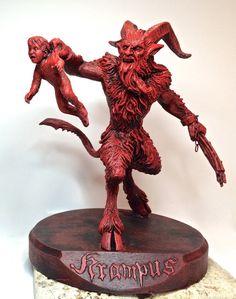 8 figure of Krampus and his wee victim      Gruss vom Krampus